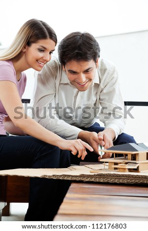 Young architects working on house model project together - stock photo