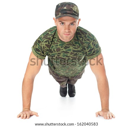 Young army soldier doing push up isolated on white background.Front view - stock photo