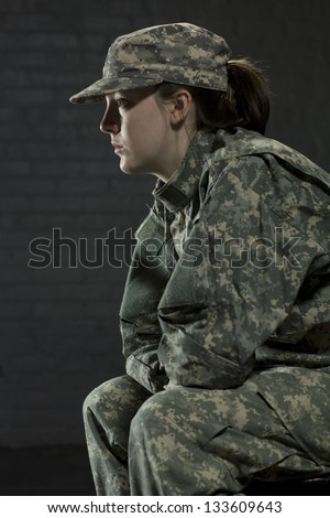 Young army woman dealing with Post Traumatic Stress Disorder - stock photo