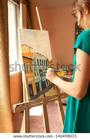 Young artist painting - stock photo