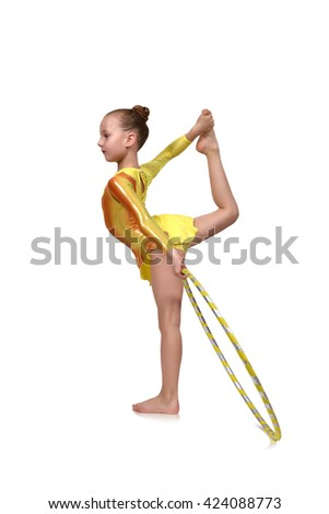 Young artistic athlete performs in yellow clothes with hula hoop - stock photo