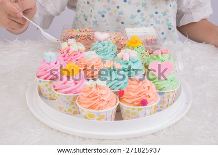Young asia woman chef cooking cake  on white background - stock photo