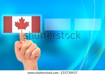 Young Asian boy hand touching button selecting Canadian option - stock photo