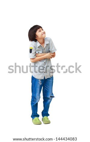 Young asian boy is looking up, Isolated over white with clipping path - stock photo