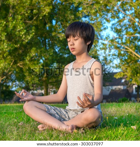 Young Asian boy playing on playground - stock photo