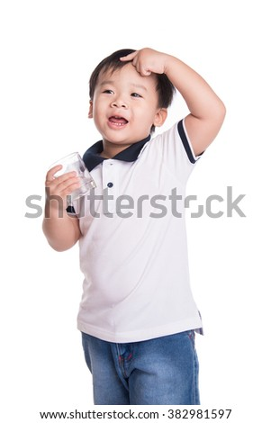Young asian boy take medicine and drink water . Heath and hospital concept - stock photo