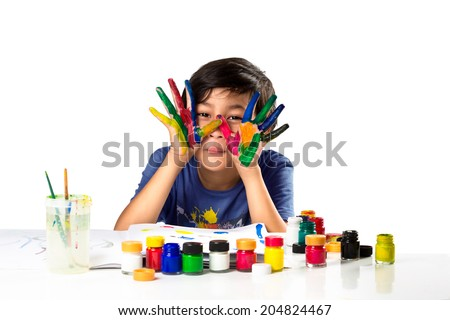 Young asian boy with hands in paint, Isolated  over white - stock photo