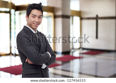 Young Asian business man in business background. - stock photo