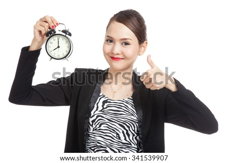 Young Asian business woman show thumbs up with a clock  isolated on white background - stock photo
