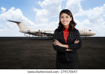 Young asian business woman smile with airplane as a background - stock photo