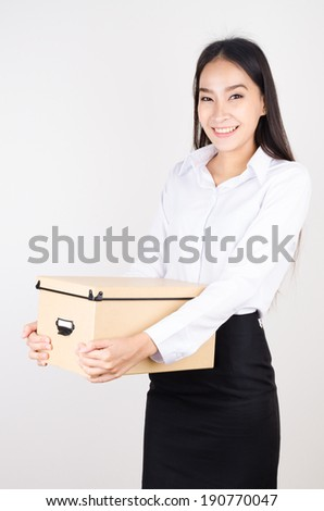 Young asian business women and the box on her hand - stock photo