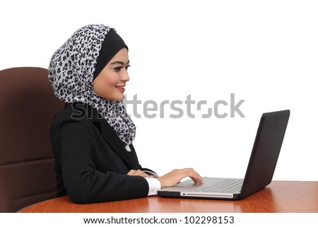 Young Asian business women with a laptop and isolated background - stock photo