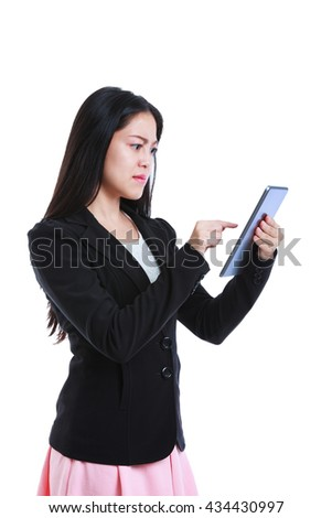 Young asian businesswoman is in an angry mood with her digital tablet. Negative human face expressions. Isolated on white background. - stock photo
