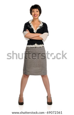 Young Asian businesswoman standing with arms crossed isolated over white background - stock photo