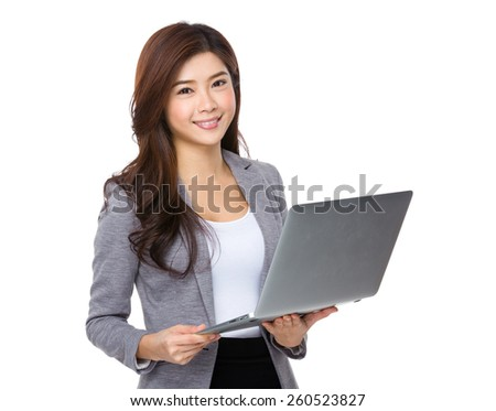 Young asian businesswoman using laptop computer - stock photo