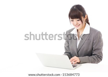 young asian businesswoman using laptop on white background - stock photo