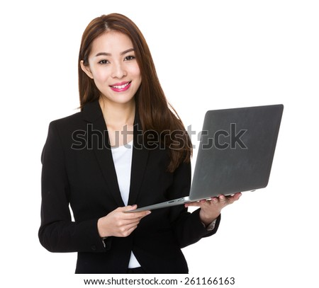 Young asian businesswoman using notebook computer - stock photo
