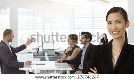 Young asian businesswoman with business team working at office. - stock photo