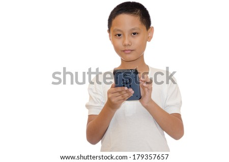 young asian child playing his smart phone - stock photo