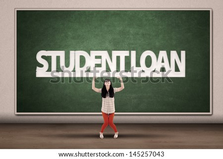 Young asian college student hold a sign of student loan - stock photo