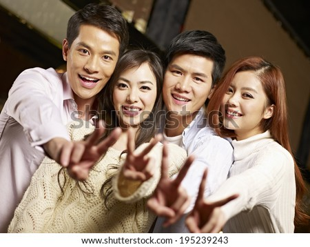 young asian couples having fun in bar. - stock photo