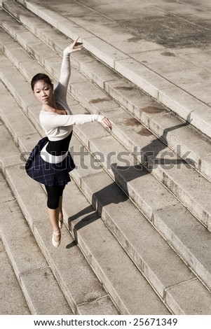 young asian female doing outdoor ballet - stock photo
