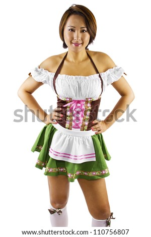 young Asian female Oktoberfest waitress - stock photo