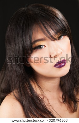 young asian female with beauty makeup on  - stock photo