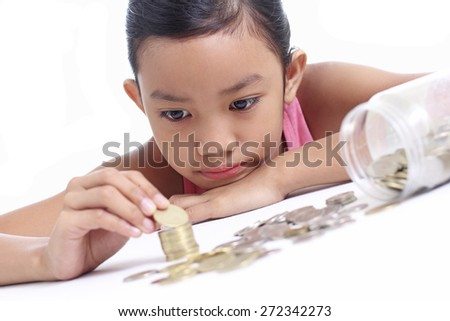 Young asian girl counting some money.  - stock photo