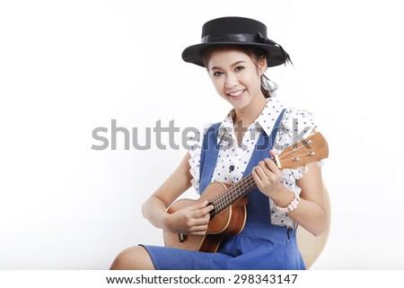 Young Asian girl holding Ukulele isolated on white background - stock photo