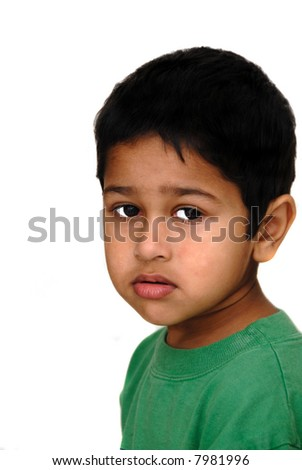 Young Asian Indian kid looking very sad - stock photo