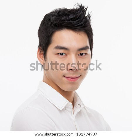 Young Asian man close up shot isolated on white - stock photo