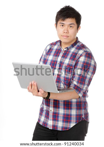 Young asian man holding laptop computer - stock photo