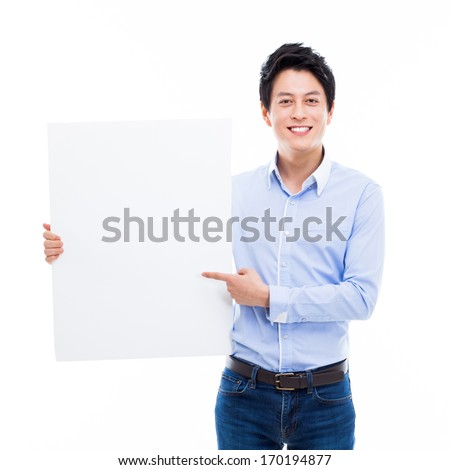Young Asian man showing a pannel card isolated on white background.  - stock photo