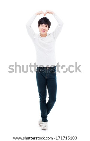 Young Asian man showing heart shape isolated on white background. - stock photo