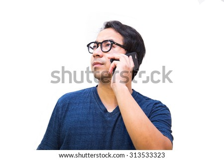Young Asian man talking on the mobile phone.(Isolated background) - stock photo