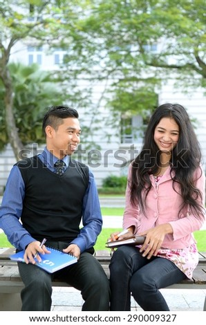 Young asian muslim woman and friend smile and happy meeting together - stock photo