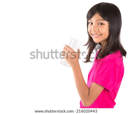 Young Asian preteen with a glass of water over white background - stock photo