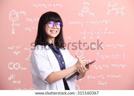 Young Asian scientist taking note on tablet smile - stock photo