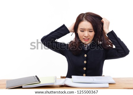 Young Asian student having trouble on the desk isolated on white background. - stock photo