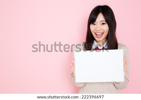 young asian student isolated on pink background - stock photo