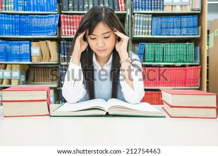 Young asian student under mental pressure - stock photo