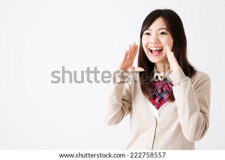 young asian student yelling on white background - stock photo