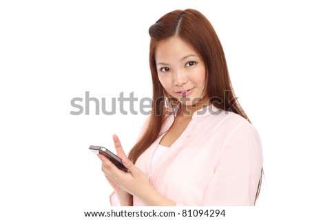 Young Asian teen using a smart phone - stock photo