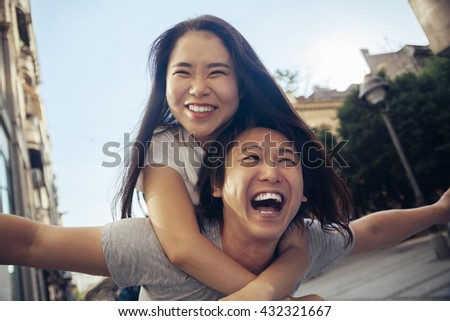 Young Asian Tourists Having Fun And Smiling - stock photo