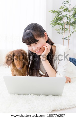 young asian woman and dog lifestyle image - stock photo