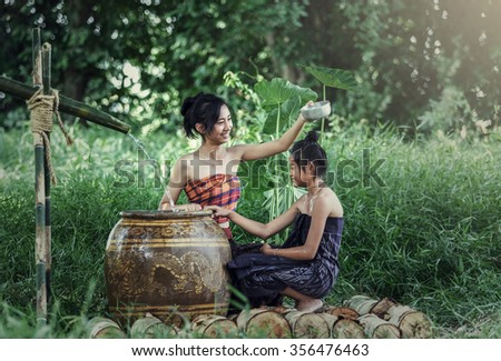 Young Asian Woman Bathing in tropical the summertime - stock photo