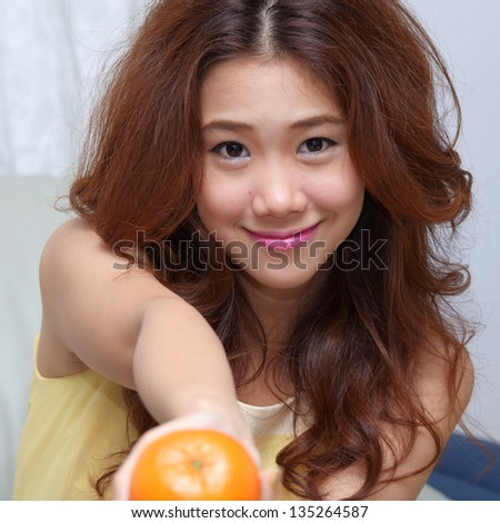 Young Asian woman close up shot. - stock photo