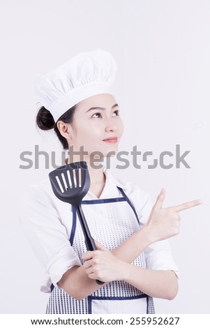 young asian woman cook holding frying  turner isolated on white background - stock photo