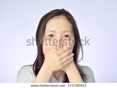 Young asian woman covering her mouth - stock photo